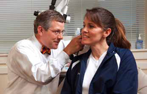 Dr. Eugene G. Brown treats a patient at the Mount Pleasant office of Charleston ENT.